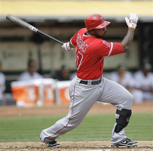 Los Angeles Angels' Howie Kendrick swings for a two-run single off Oakland Athletics' Brandon McCarthy in the third inning of a baseball game on Wednesday, Sept. 5, 2012, in Oakland, Calif. (AP Photo/Ben Margot)