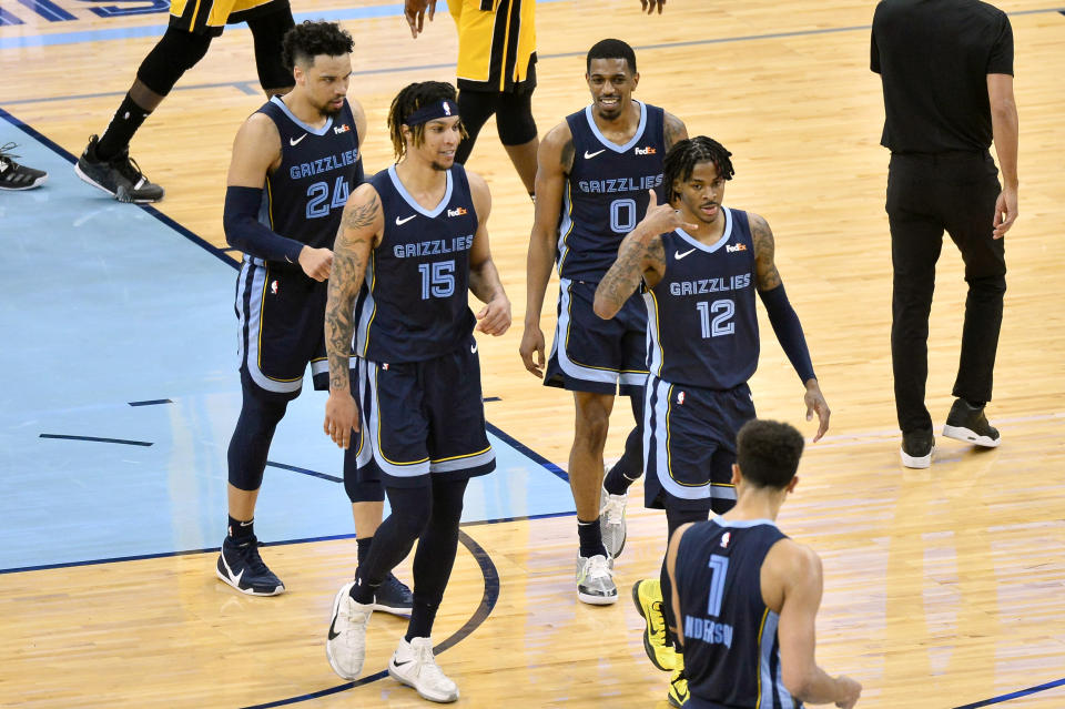 Memphis Grizzlies guard Ja Morant (12) gestures after scoring the game winning shot in the second half of an NBA basketball game against the Miami Heat Wednesday, March 17, 2021, in Memphis, Tenn. (AP Photo/Brandon Dill)