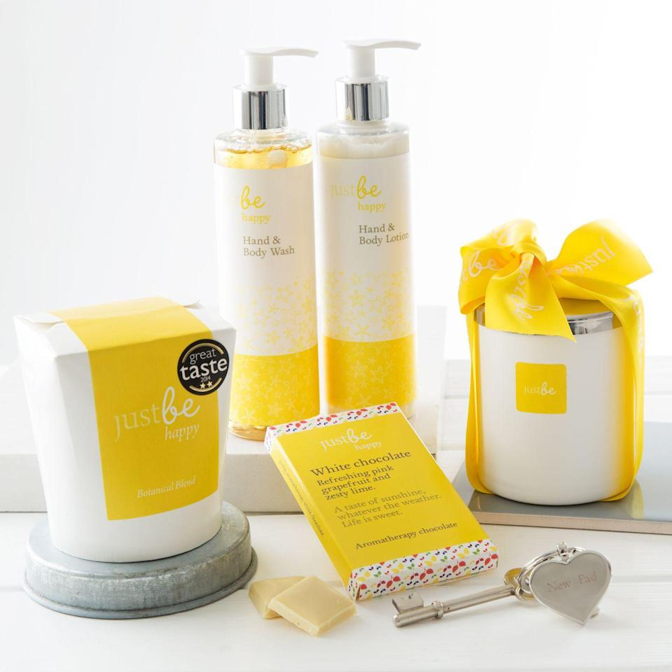 """<p><a rel=""""nofollow noopener"""" href=""""https://www.notonthehighstreet.com/justbebotanicals/product/create-your-own-new-home-hamper"""" target=""""_blank"""" data-ylk=""""slk:BUY NOW"""" class=""""link rapid-noclick-resp"""">BUY NOW</a> <strong>Notonthehighstreet.com, £39.95</strong></p><p>This is the perfect hamper to spoil someone with feel-good goodies for their new home. The hamper from JustBe Botanicals includes an engraved JustBe keyring which can be personalised with names, titles, a message or date, along with a Happy Hand Wash & Lotion. You can also choose to add a chocolate bar, aromatherapy soy candle and herbal tea.</p>"""