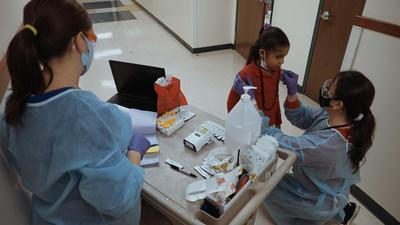An elementary school student receives a rapid antigen test using the BD Veritor™ Plus System for Rapid Detection of SARS-CoV-2.