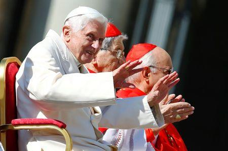 Emeritus Pope Benedict XVI waves before a mass in Saint Peter's square at the Vatican