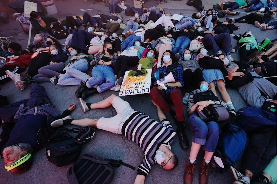 """<span class=""""caption"""">Climate activists protest outside of the first French leaders' debate in Montréal, Que. on Sept. 2, 2021. </span> <span class=""""attribution""""><span class=""""source"""">(THE CANADIAN PRESS/Nathan Denette)</span></span>"""