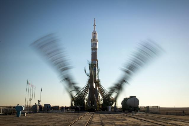 BAIKONUR, KAZAKHSTAN - NOVEMBER 05: In this handout image provided by NASA, The Soyuz TMA-11M rocket, adorned with the logo of the Sochi Olympic Organizing Committee and other related artwork, is seen in this long exposure photograph, as the service structure arms are raised into position at the launch pad at the Baikonur Cosmodrome on November 5, 2013 in Baikonur, Kazakhstan. Launch of the Soyuz rocket is scheduled for November 7 and will send Expedition 38 Soyuz Commander Mikhail Tyurin of Roscosmos, Flight Engineer Rick Mastracchio of NASA and Flight Engineer Koichi Wakata of the Japan Aerospace Exploration Agency on a six-month mission aboard the International Space Station. Photo Credit: (Photo by Bill Ingalls/NASA via Getty Images)