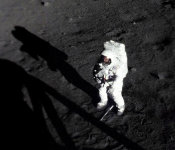 On July 20, 1969, Apollo 11 astronaut Neil Armstrong became the first man to walk on the moon. Armstrong is pictured here, shortly after collecting a sample of lunar dust and rocks. At his feet is the handle for the sample collection tool.