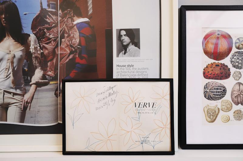 Forget gallery walls: Propping up your frames gives your space a laid-back feel, especially if they're vintage.