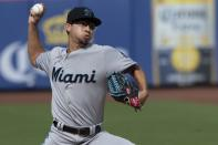 Miami Marlins starting pitcher Robert Dugger delivers in his major league debut during the first inning of a baseball game against the New York Mets, Monday, Aug. 5, 2019, in New York. (AP Photo/Mary Altaffer)