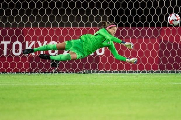 Canada's goalkeeper Stephanie Labbé saves a penalty by Brazil's midfielder Andressa during the Tokyo 2020 Olympic Games women's quarter-final football match between Canada and Brazil at Miyagi Stadium in Miyagi, Japan, on Friday. Canada won the watch 4-3 on penalties. (AFP via Getty Images - image credit)