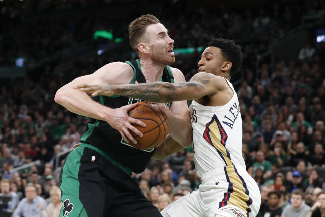 New Orleans Pelicans' Nickeil Alexander-Walker tries to stop Boston Celtics' Gordon Hayward during the first half of an NBA basketball game Saturday, Jan. 11, 2020, in Boston. (AP Photo/Winslow Townson)