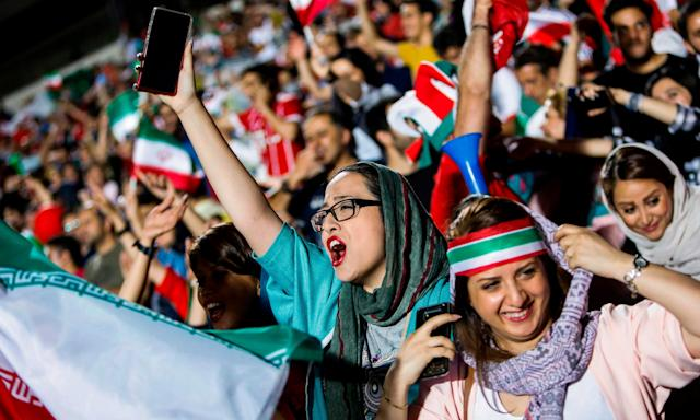 Iranian women supporters get a taste of watching live football in a stadium, although this was on a giant screen in Tehran's Azadi stadium, after a ban on such activity was relaxed.