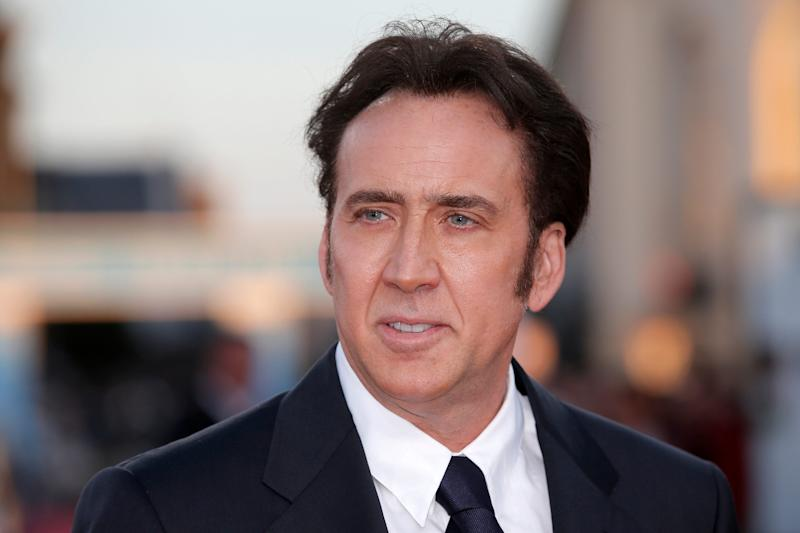 """Nicolas Cage gave Jim Carrey a rave review of the book """"Memoirs and Misinformation,"""" which portrays the """"National Treasure"""" star with an affinity for semi-naked jiujitsu and prophetic visions of saber-toothed tigers."""