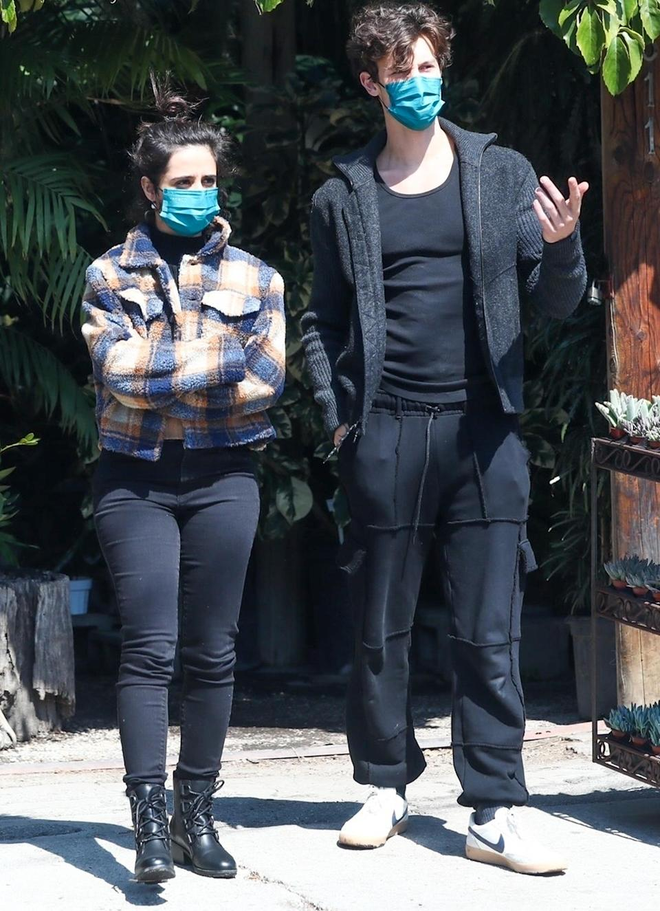 <p>Lovebirds Camila Cabello (in SOREL Cate Lace boots) and Shawn Mendes go shopping for plants on Monday in L.A.</p>