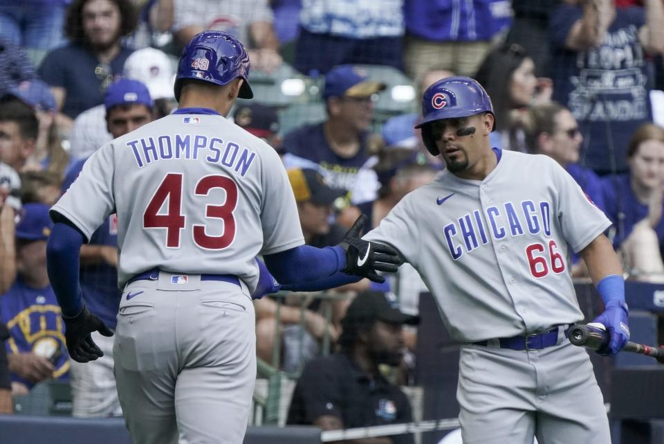 Chicago Cubs' Trayce Thompson is congratulated by Rafael Ortega after hitting a home run during the fifth inning of a baseball game against the Milwaukee Brewers Sunday, Sept. 19, 2021, in Milwaukee. (AP Photo/Morry Gash)