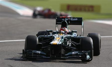 Caterham Formula One driver Kovalainen drives during the first practice session of the Abu Dhabi F1 Grand Prix at the Yas Marina circuit on Yas Island