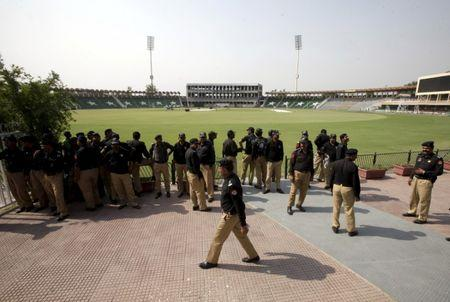 FILE PHOTO: Policemen stand inside the Gaddafi Stadium during preparation ahead of cricket series between Pakistan and Zimbabwe in Lahore, Pakistan, May 16, 2015.  REUTERS/Mohsin Raza