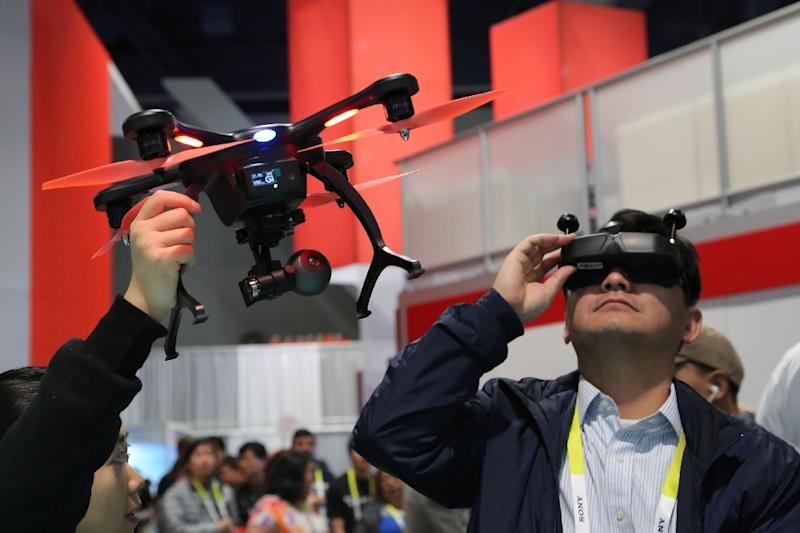 Drones and virtual reality are likely to cause fresh disruption for news organizations in the coming years (AFP Photo/DAVID MCNEW)