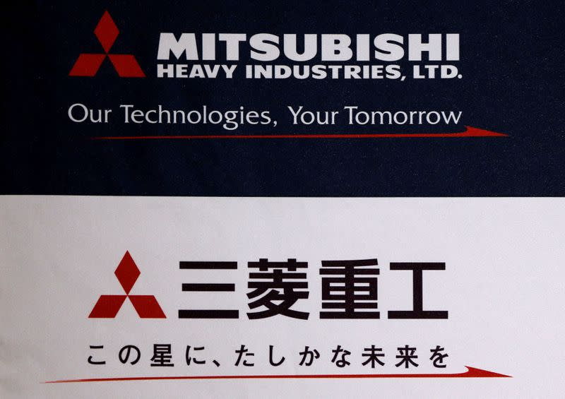 FILE PHOTO: The logo of Mitsubishi Heavy Industries is seen at the company's news conference in Tokyo