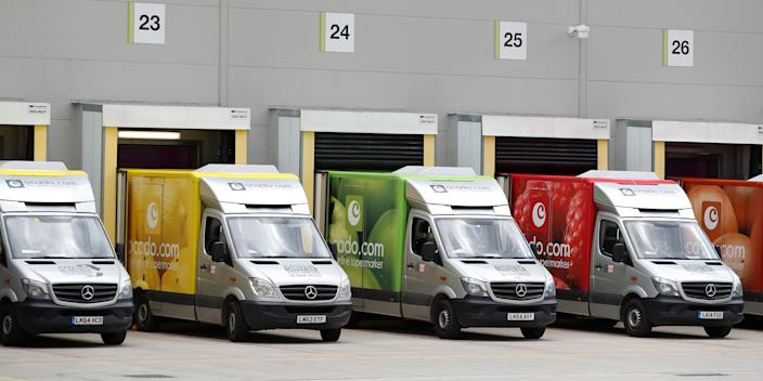 Delivery vans are lined up prior to dispatch at the Ocado Customer Fulfilment Centre in Andover, England, on May 1, 2018.