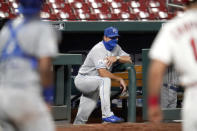 Kansas City Royals manager Mike Matheny watches from the top step of the dugout during the third inning of a baseball game against the St. Louis Cardinals Monday, Aug. 24, 2020, in St. Louis. (AP Photo/Jeff Roberson)