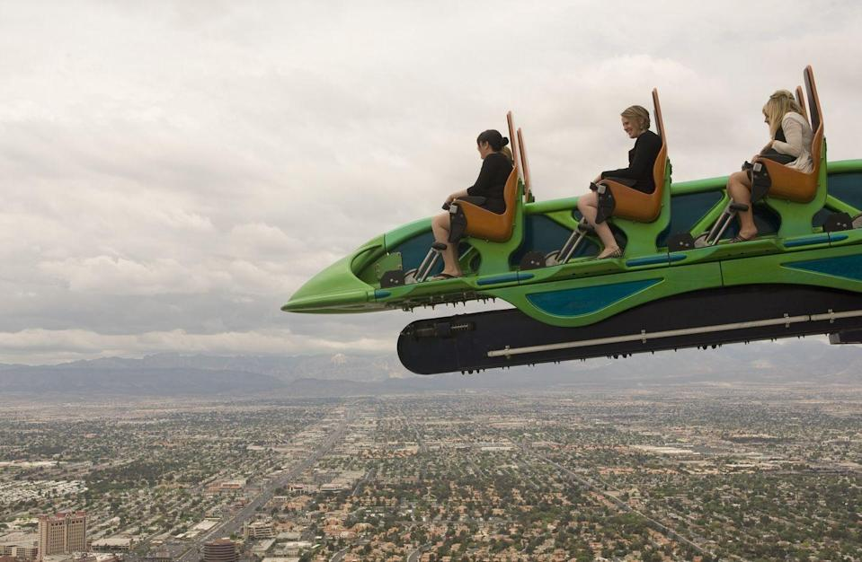 """<p>This one isn't located at a theme park per se — it dangles from the top of the <a href=""""https://www.thestrat.com/attractions/thrill-rides"""" rel=""""nofollow noopener"""" target=""""_blank"""" data-ylk=""""slk:Stratosphere Hotel"""" class=""""link rapid-noclick-resp"""">Stratosphere Hotel</a> in Las Vegas, making it one of the five highest-situated thrill rides in the world. When riders look over the side, they see an 866-foot drop. But is this a gamble you'd want to take?</p>"""