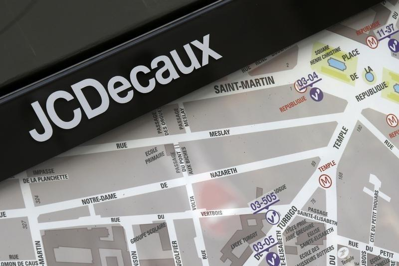 The logo of outdoor advertising group JCDecaux is seen near an information panel with a neighbourhood map in Paris