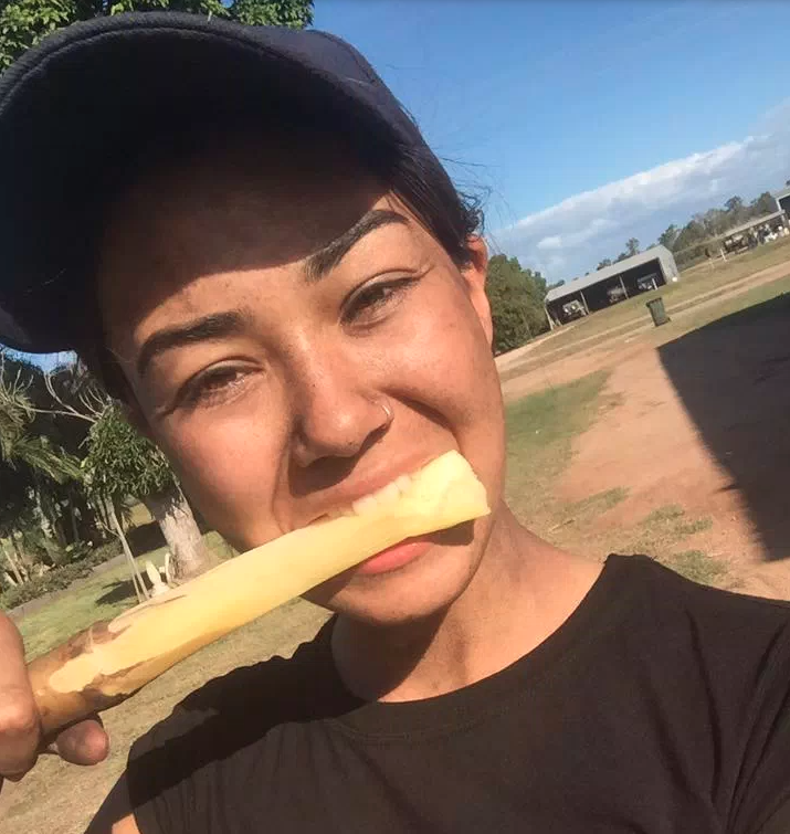Mia Ayliffe-Chung bites into a piece of fruit.