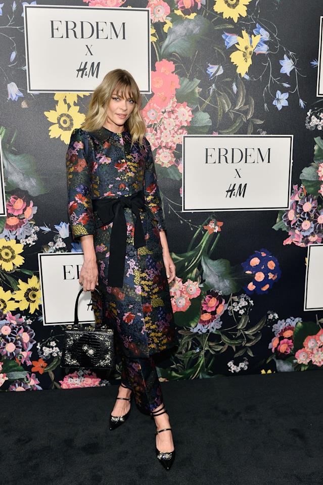 <p>The actress and model worked a long-sleeved, midi dress with a tie waist. [Photo: Courtesy of H&M] </p>