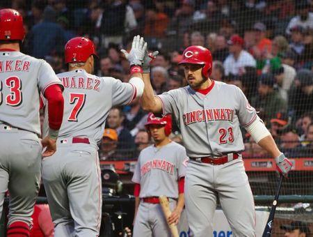 May 15, 2018; San Francisco, CA, USA; Cincinnati Reds third baseman Eugenio Suarez (7) high fives on deck batter first baseman Adam Duvall (23) after hitting a two run home run to drive in left fielder Jesse Winker (left) against the San Francisco Giants during the third inning at AT&T Park. Mandatory Credit: Kelley L Cox-USA TODAY Sports