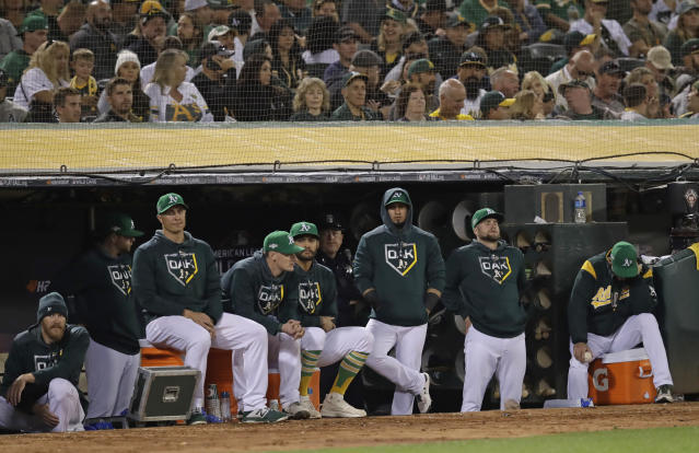 Oakland Athletics watch from the dugout in the eighth inning of an American League wild-card baseball game against the Tampa Bay Rays on Wednesday, Oct. 2, 2019, in Oakland, Calif. (AP Photo/Ben Margot)