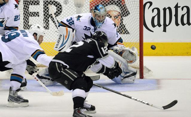 Los Angeles Kings right wing Marian Gaborik, front, of Slovakia, tries to get a shot in on San Jose Sharks goalie Alex Stalock as center Joe Thornton reaches in during the second period in Game 6 of an NHL hockey first-round playoff series, Monday, April 28, 2014, in Los Angeles. (AP Photo)