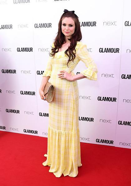 <p>We weren't too fond of Sophie Ellis Bextor's yellow gingham dress that looked slightly like a picnic rug. <i>[Photo: Mike Marsland/Mike Marsland/WireImage]</i></p>