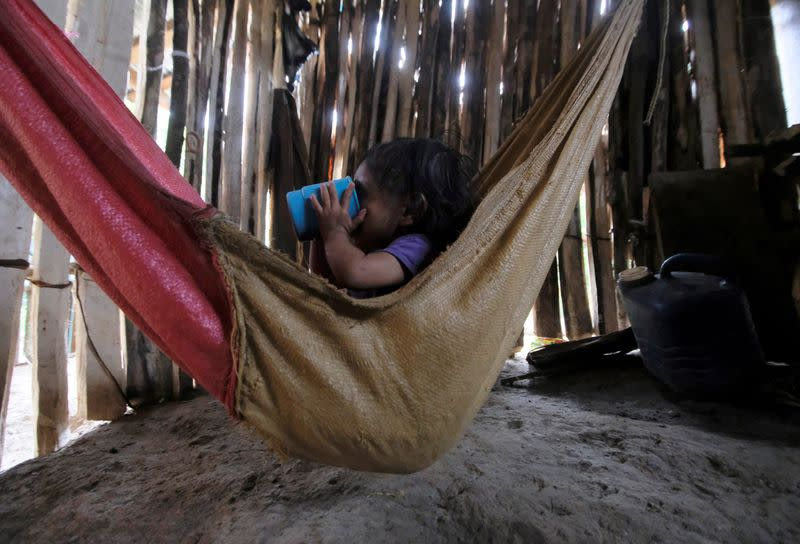 Yesmin Anayeli Perez, a 22-months-old girl diagnosed with severe malnutrition, drinks Incaparina, a protein vegetable food handed out by the government, at her home, in La Ceiba