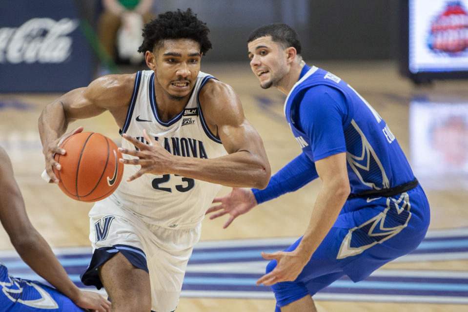 Creighton forward Damien Jefferson (23) moves past Creighton guard Marcus Zegarowski (11) during the first half of an NCAA college basketball game Wednesday, March 3, 2021, in Villanova, Pa. (AP Photo/Laurence Kesterson)