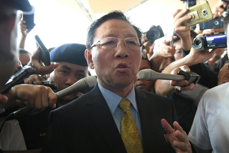 Expelled North Korean ambassador to Malaysia Kang Chol speaks to journalists outside the departure hall of the Kuala Lumpur International Airport in Sepang on March 6, 2017