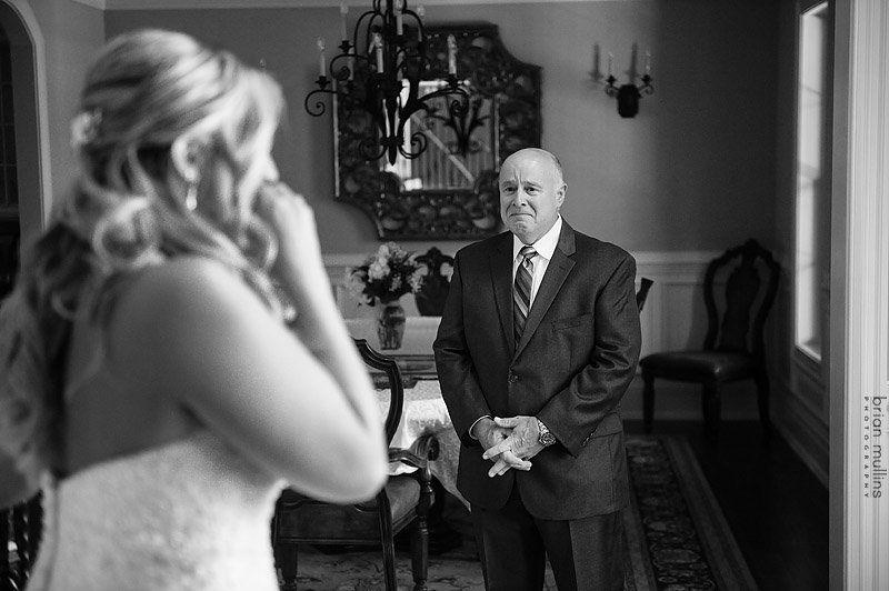 """I have a younger daughter so when the daughter and dad see each other on the wedding day is such a special moment for me. The bride got ready at her parents' house and she walked down the stairs to see her dad. I always try to talk with Dad prior so he knows this is the last moments he gets to spend with his daughter before she's married, so to enjoy it and don't be afraid to show emotion. So the bride is crying, the dad is crying, and I am crying. Thank god for autofocus."" -- <i>Brian Mullins</i>"