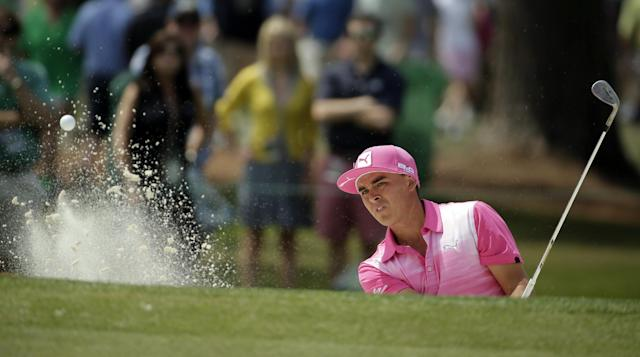 Rickie Fowler hits out a bunker on the seventh hole during the second round of the Masters golf tournament Friday, April 11, 2014, in Augusta, Ga. (AP Photo/Chris Carlson)