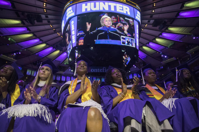 Hunter College graduates from the School of Arts and Science applaud as former Secretary of State Hillary Clinton delivers Hunter College's commencement address, Wednesday, May 29, 2019, in New York. (AP Photo/Mary Altaffer)
