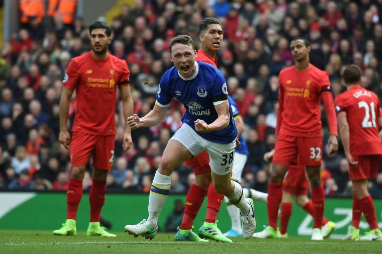 Everton's Matthew Pennington (C) celebrates after scoring a goal during their English Premier League match against Liverpool, at Anfield in Liverpool, on April 1, 2017