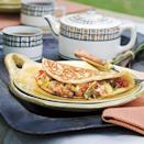 """<p>A feather-light cornbread batter takes the place of <a href=""""https://www.myrecipes.com/egg-recipes"""" rel=""""nofollow noopener"""" target=""""_blank"""" data-ylk=""""slk:eggs"""" class=""""link rapid-noclick-resp"""">eggs</a> in these fun omelets.</p>"""