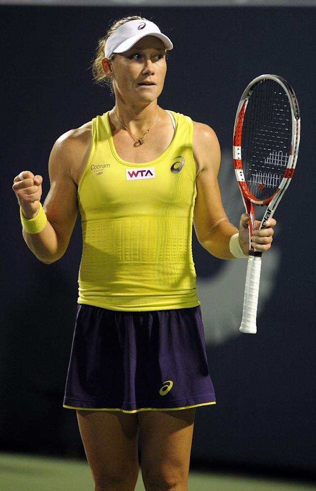 Samantha Stosur, of Australia, reacts after her 6-3, 4-6, 6-3, victory over Kirsten Flipkens, of Belgium, in a quarterfinal match at the New Haven Open tennis tournament in New Haven, Conn., on Thursday, Aug. 21, 2014. (AP Photo/Fred Beckham)
