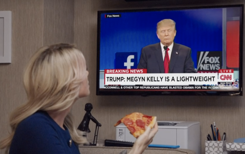 In the new Bombshell trailer, we see Megyn Kelly, played by Charlize Theron, hearing Trump's infamous menstruating comment about her. (Screenshot: Ellen DeGeneres via Ellen Tube)