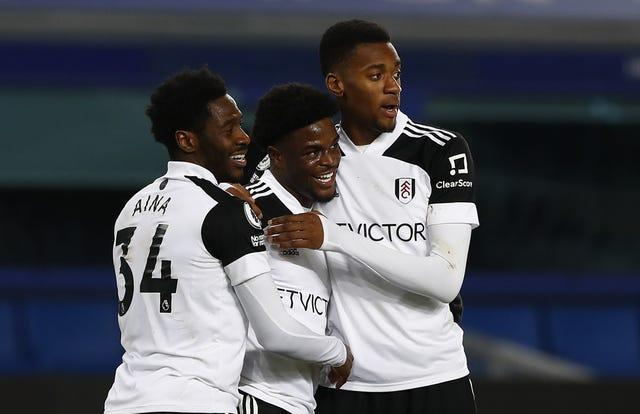 Fulham's Josh Maja (centre) celebrates with Ola Aina (left) and Tosin Adarabioyo.