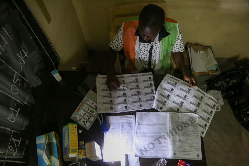 Election official starts to count the ballots during the presidential election in Abidjan
