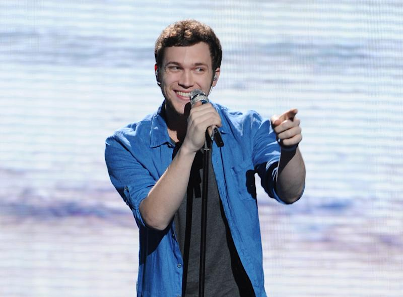 "FILE - In this May 9, 2012 file photo provided by Fox, contestant Phillip Phillips performs on the singing competition series ""American Idol,"" in Los Angeles. With the eleventh season finale of ""American Idol"" just a week away, many fans of the Fox talent contest aren't wondering who will capture the title, but whether sassy 16-year-old diva-in-training Jessica Sanchez or booming 20-year-old vocal showstopper Joshua Ledet would even have the votes to beat bluesy 21-year-old front-runner Phillip Phillips. (AP Photo/Fox, Michael Becker, File)"