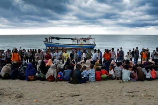 Evacuated Rohingya sit on the beach near Lancok village, in Indonesia's North Aceh Regency