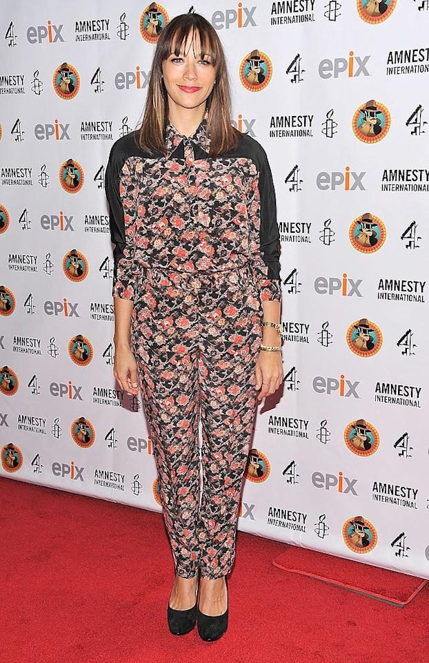 "You know those busily patterned carpets in Vegas casinos that never seem to get dirty even though they've had dirt ground into them and been thrown up on millions of times? Well, we're reminded of them every time we look at the horrifying top and trousers Rashida Jones wore to a recent Amnesty International soiree. I suppose the good news is the ""Parks and Recreation"" star could get sick all over herself and nobody would notice... actually, that isn't good news. (3/4/2012)"