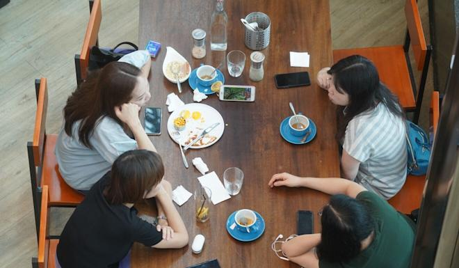 A group of friends eat lunch together at a restaurant in Hollywood Plaza in Diamond Hill. Photo: Winson Wong