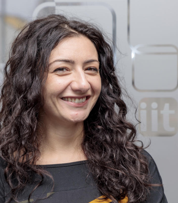 Italian Institute of Technology, IIT researcher Velia Siciliano poses for a portrait in this Jan. 1, 2018 photo at the IIT in Genoa, Italy. Backed by 261 billion euros from the EU and Italian government, the country's recovery plan calls for a top-to-bottom shakeup of a major industrial economy long hampered by red tape, a fear of change, and bureaucratic and educational inertia. Leading the charge is Premier Mario Draghi, the former head of the European Central Bank, who was tapped as head of a national unity government specifically for his economic expertise and institutional knowledge both in Italy and the EU.A key target is keeping more young Italians from taking their know-how abroad, a perennial issue in Italy, which has one of the lowest rates of university graduates in Europe and one of the largest brain drains. (Duilio Farina/IIT via AP)