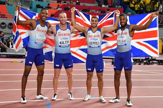 Zharnel Hughes, Richard Kilty, Adam Gemili and Nethaneel Mitchell-Blake celebrate silver after the Men's 4x100m Relay final. (Photo by ANDREJ ISAKOVIC / AFP) (Photo by ANDREJ ISAKOVIC/AFP via Getty Images)