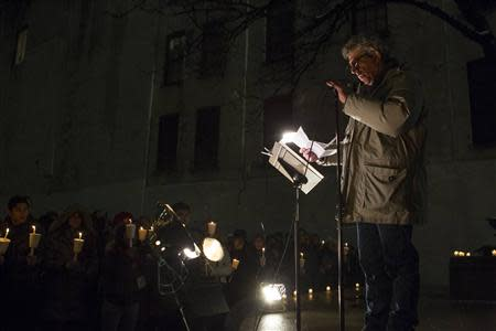 Actor Eric Bogosian speaks at a candle light vigil for late actor Phillip Seymour Hoffman in the Manhattan borough of New York