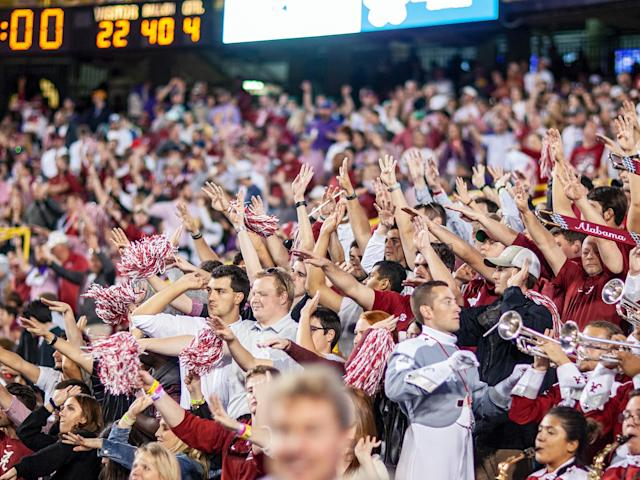 "BATON ROUGE, LA - NOVEMBER 03: <a class=""link rapid-noclick-resp"" href=""/ncaaf/teams/alabama/"" data-ylk=""slk:Alabama Crimson Tide"">Alabama Crimson Tide</a> fans cheer from the stands during a game between the <a class=""link rapid-noclick-resp"" href=""/ncaaf/teams/lsu/"" data-ylk=""slk:LSU Tigers"">LSU Tigers</a> and Alabama Crimson Tide on November 3, 2018 at Tiger Stadium, in Baton Rouge, Louisiana. (Photo by John Korduner/Icon Sportswire via Getty Images)"